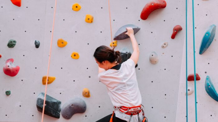 Young woman on a climbing wall