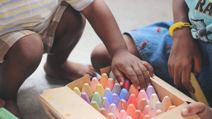 Two childre playing with chalk